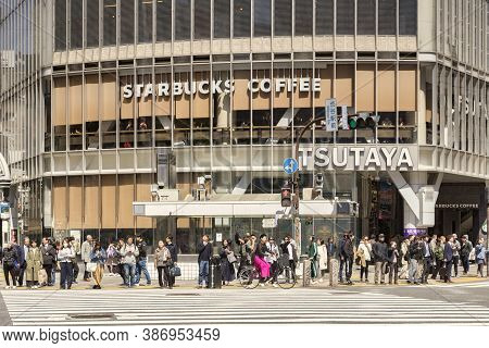 9 April 2019: Tokyo, Japan - Crowd Of People Waiting To Cross The Road At Shibuya Crossing, With Sta