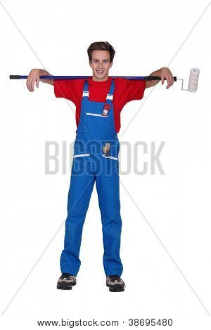 Young decorator with a ceiling roller