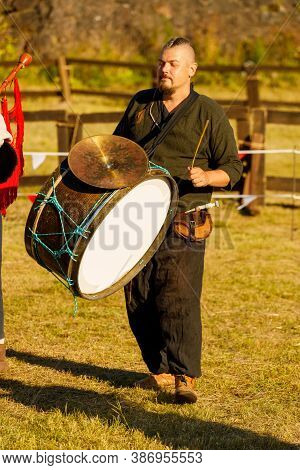 Russia. Vyborg. 2020 A Man In A Medieval Costume Plays A Drum At A Summer Festival