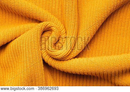 Orange Textile Background Knitwear. Wool Background, Top View. Abstract Fresh Colorful Yellow Knitte