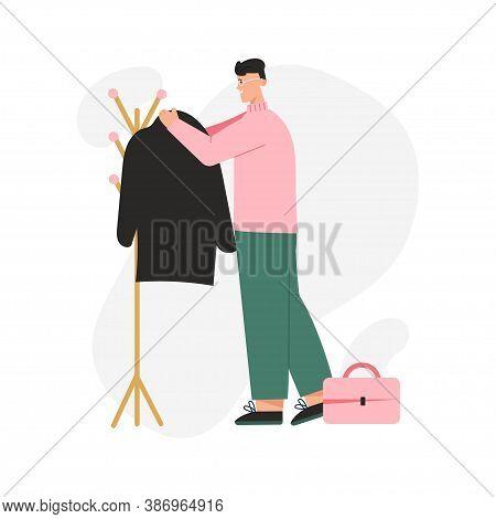 Happy Man Hangs His Coat On Outerwear Rack