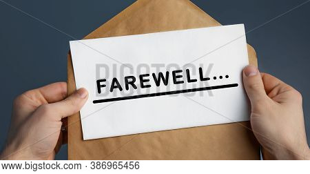 Cropped View Of Man Holding Craft Envelope With Text Farewell On Blue Background, Concept