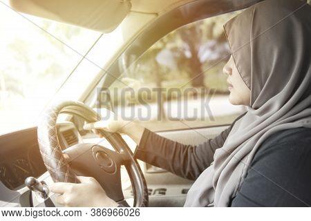 Portrait Of Young Asian Muslim Woman Smiling And Driving A Car, Good Looking Entrepreneur, Car Shari