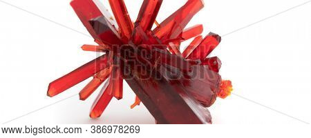 Red crystal of natural origin. Natural geological material for use in technology and jewelry