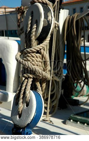 Tall Ship Detail. Ropes And Wooden Pulleys