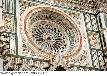 Florence Cathedral, Duomo Of Santa Maria Del Fiore, Closeup Of The Main Facade With The Rose Window.