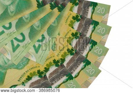 20 Canadian Dollars Bills Lies Isolated On White Background With Copy Space Stacked In Fan Shape Clo