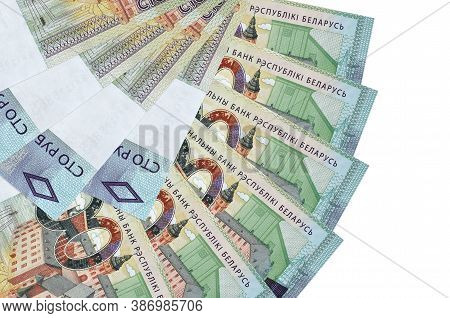 100 Belorussian Rubles Bills Lies Isolated On White Background With Copy Space Stacked In Fan Shape