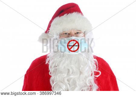 Santa Claus Covid-19. Santa wears a Paper Medical Face Mask with a NO CORONAVIRUS Logo on the front. Isolated on white. Coronavirus is dangerous and world wide.