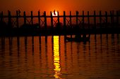 famous tick  bridge at sunset in Myanmar poster