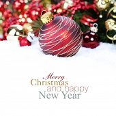 Christmas ball and Christmas tree with decorations (with sample text) poster