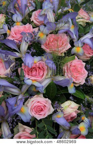Blue Irises And Pink Roses In Bridal Arrangement