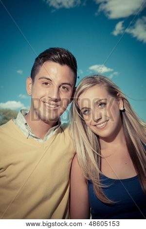 Portrait Of A Young Couple Smiling Outside