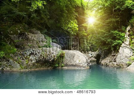 Deep forest waterfall at