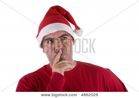 Man Wearing Red Santa Hat With Full Of Thoughts Expression