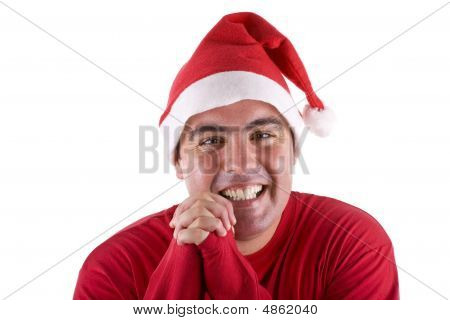 Man Wearing Red Santa Hat Praying And Smiling