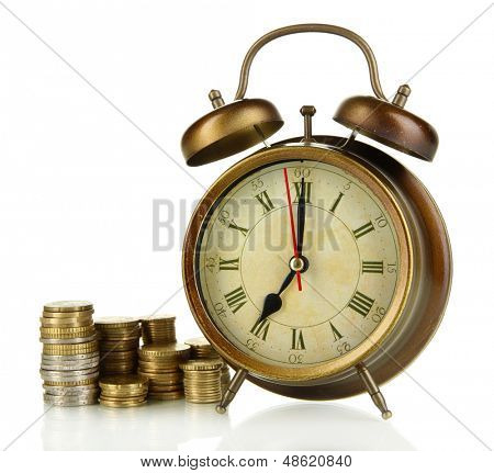 Antique clock and coins isolated on white
