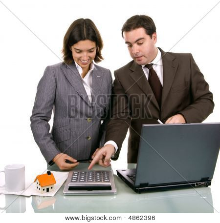Two Friendly Business Partners Working On A Laptop Computer