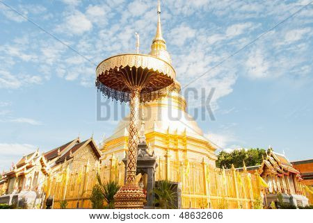 Phra That Hari Phunchai Golden Pagoda In Thai Temple At Lamphun Province, Northern Thailand.