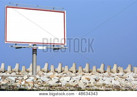Blank White Billboard Breakwater And Sky