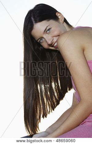 Side view portrait of beautiful young woman against clear sky