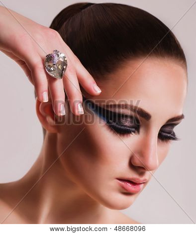 Fashionable woman with jewelry ring. Fashion portrait