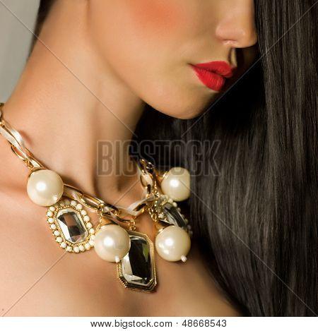 Fashion woman with jewelry precious decorations.