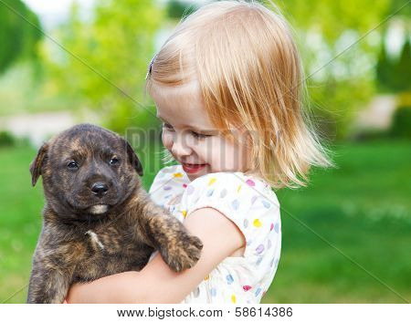 Cute little girl hugging dog puppy. Friendship and care concept poster