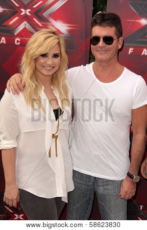 Demi Lovato and Simon Cowell at