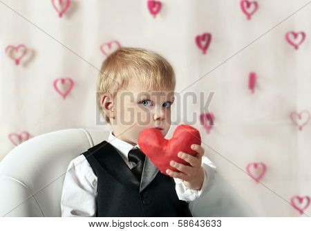 Valentine's Day - cute child with red Heart in hands.