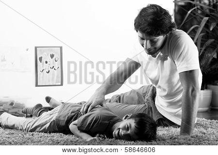 Happy Dad Tickling Son