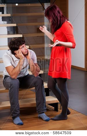 Woman Standing By Husband And Moaning
