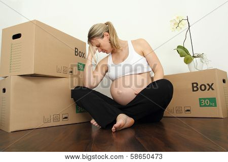 Exhausted Pregnant Moving With Packing Case