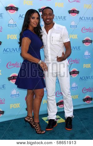 Brandon T. Jackson and Denise Marie Xavier at the 2013 Teen Choice Awards Arrivals, Gibson Amphitheatre, Universal City, CA 08-11-13
