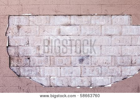 Hole In Render On Wall Showing Bricks