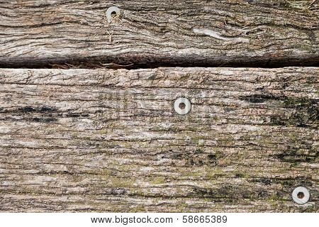 Texture Of Old Weathered And Discolored Wooden Boards