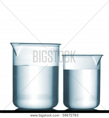 Isolated Chemical Plastic Beakers On Table With Solution