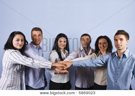 United  Group Of Business People With Hands Together