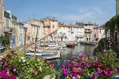 Martigues (Bouches-du-Rhone Provence-Alpes-Cote d'Azur France): the old harbor with boats and flowers poster