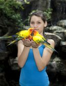 female teenager with sun conure trusting bird poster