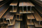 Close-up of rusty steel beams stacked at a construction site t-shirt