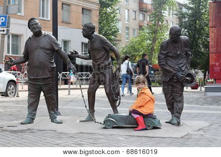 PERM RUSSIA - JUL 18 2013: Little girl near city sculpture is dedicated to famous characters of film