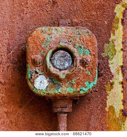 Old Electric Switch On A Rusty Iron Wall