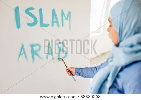 Arabic Muslim girl writing messages on board