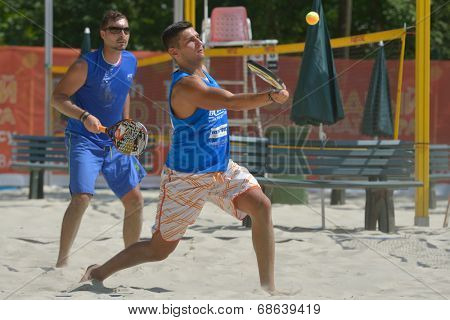 MOSCOW, RUSSIA - JULY 16, 2014: Emil Argirov (in front) and Rosen Nentchev of Bulgaria on the training before the ITF Beach Tennis World Team Championship. Russia hosts the championship for 3rd time