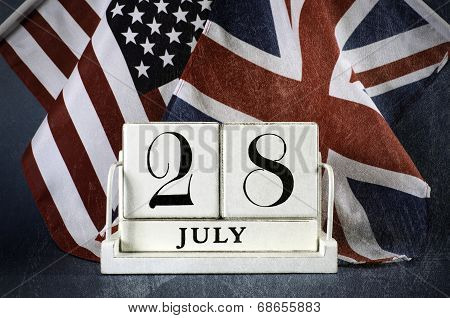 Aged grunge style vintage style white block calendar for 28 July start of World War I centenary 1914 to 2014 with USA stars and stripes and UK Union Jack flag. poster