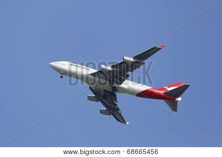 Qantas Airline Boeing 747-400 in New York sky before landing at JFK Airport
