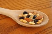 Trail Mix (Peanuts Almonds Sunflower Seeds & Raisins) on Wooden Spoon poster