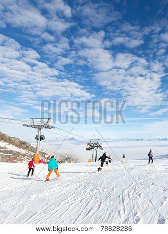 People Skiing And Ski Lift
