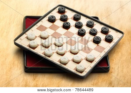 Traveling Draughts On Aged Background